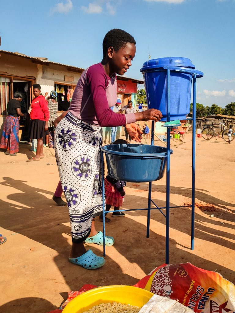 Woman washing hands at the market